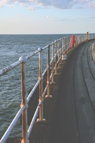 Whitby Pier with its rusty railings with views to sea