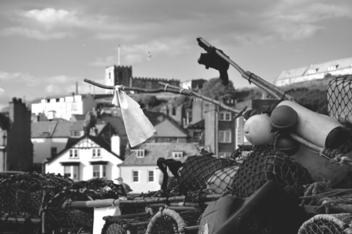 Black and white picture of fishing tackle by the bay in Whitby